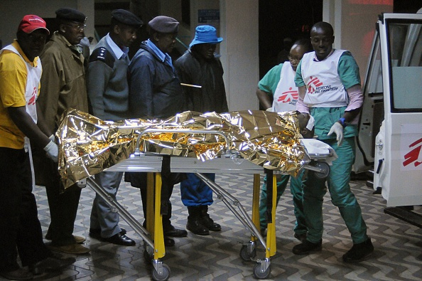 A victim of a collapsed building arrives at the Kenyatta National hospital in Nairobi, on January 04, 2015. A high-rise building collapsed in the Kenyan capital on January 4, leaving at least a dozen injured and an unknown number of others trapped under rubble, officials and witnesses said. (SIMON MAINA/AFP/Getty Images)