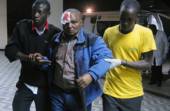 A victim of a collapsed building arrives at the Kenyatta National hospital in Nairobi, on January 04, 2015. A high-rise building collapsed in the Kenyan capital on January 4, leaving at least a dozen injured and an unknown number of others trapped under rubble, officials and witnesses said. AFP PHOTO / SIMON MAINA        (Photo credit should read SIMON MAINA/AFP/Getty Images)