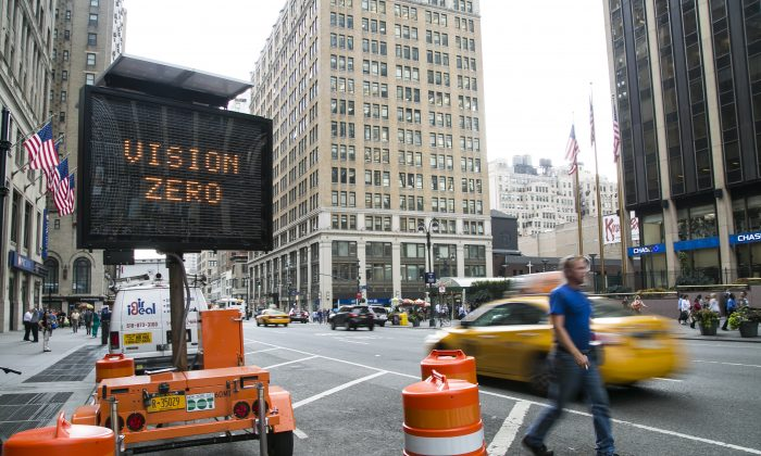 A digital board displays safety messages in front of Penn Station in Manhattan, N.Y., on Sept. 10, 2014. There were 256 traffic fatalities in New York in 2014 as of Dec. 23, compared to 286 traffic fatalities in 2013. (Samira Bouaou/Epoch Times)