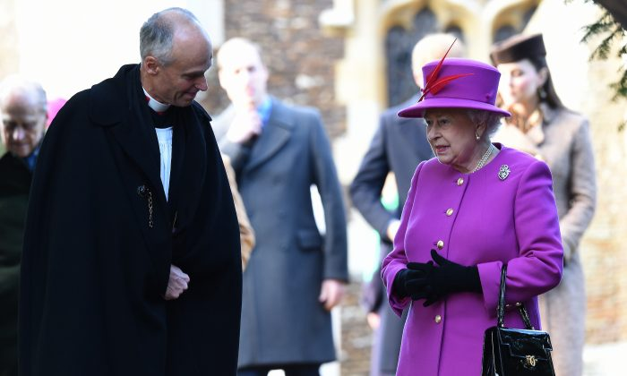 Britain's Queen Elizabeth II leaves after attending with other members of the royal family the traditional Christmas Day Church Service at Sandringham in eastern England, on December 25, 2014. (AFP/Getty Images)