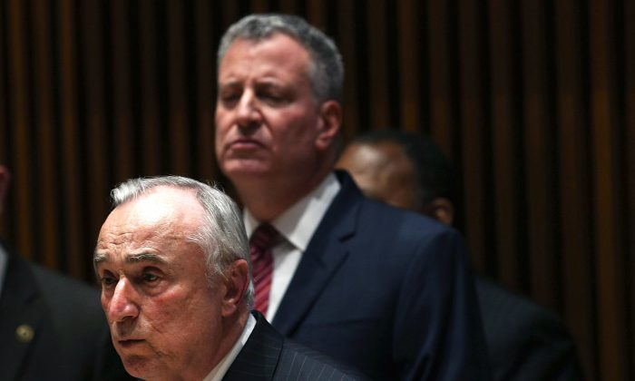 New York Police Commissioner Bill Bratton speaks at a news conference at police headquarters to announce new figures on decreasing crime and violence January 5, 2015 in New York City. On Sunday, police officers defied Bratton by turning their backs on the mayor once again during his speech at the funeral for an officer fatally shot last month with his partner in Brooklyn. (Photo by Spencer Platt/Getty Images)