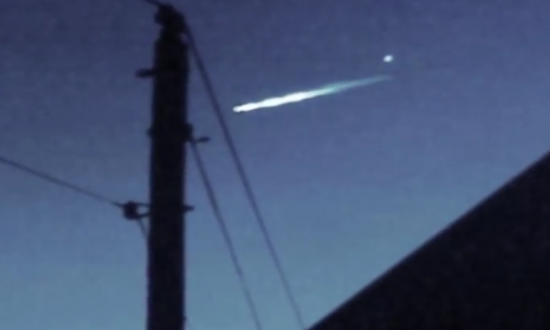 This still image from a YouTube video shows an object, the circle on the top right, after it separated from a streaking meteor. (Ken Roberts/YouTube)
