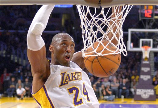 Los Angeles Lakers guard Kobe Bryant dunks during the first half of an NBA basketball game against the Indiana Pacers, Sunday, Jan. 4, 2015, in Los Angeles. (AP Photo/Mark J. Terrill)