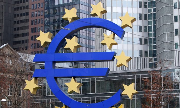 A sculpture featuring the EURO logo is pictured in front of the European Central Bank (ECB) in Frankfurt am Main, western Germany, Dec. 2, 2014. (Daniel Roland/AFP/Getty Images)