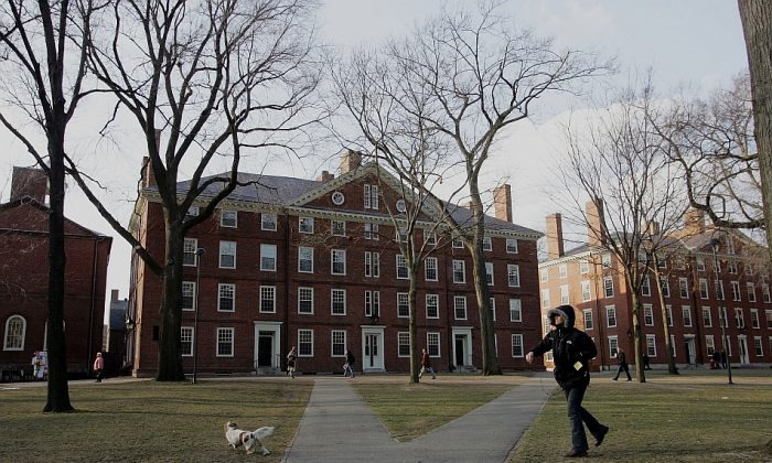 Harvard University students on campus in Cambridge, Mass., on Feb. 21, 2006. The school recently agreed to lower its burden of proof for sexual assault disciplinary cases after an investigation by the OCR. (Joe Raedle/Getty Images)