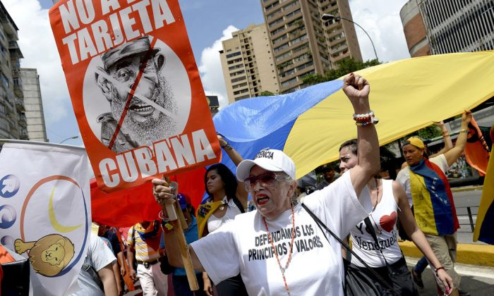 People march during a protest against the government of Venezuelan President Nicolas Maduro, in Caracas on Oct. 18, 2014. Public unrest is growing in Venezuela. (Federico Parra/AFP/Getty Images)