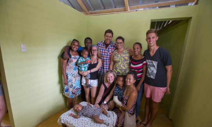 Boston Pizza employees pose with beneficiaries in one of three homes they built in the Dominican Republic in 2014, in partnership with the charity Live Different. (Courtesy Boston Pizza)
