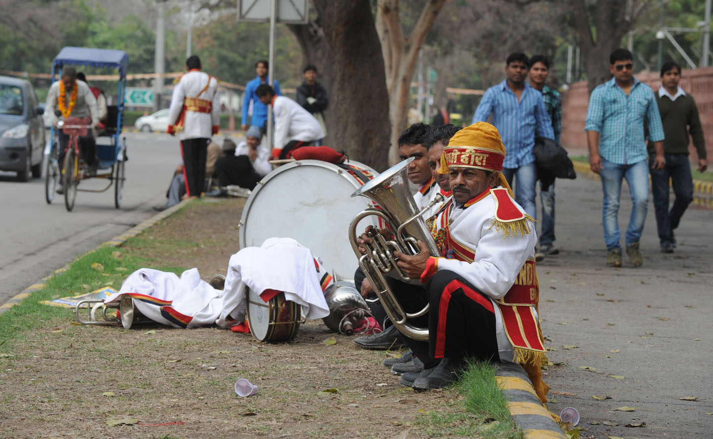Members Of An Indian Wedding Band Wait On A Road Divider In New Delhi Feb