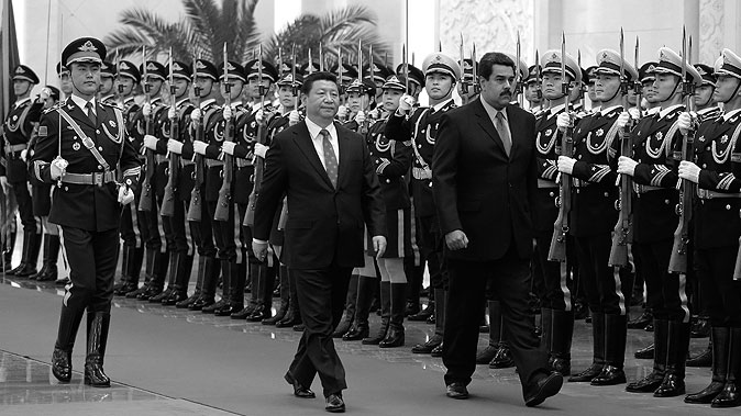 Venezuela's President Nicolas Maduro (R) walks with Chinese President Xi Jinping (L) as they review an honor guard during a welcoming ceremony at the Great Hall of the People on Jan. 7, 2015, in Beijing, China. (Andy Wong/Getty Images)