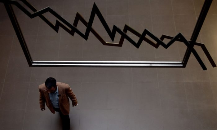 An employee walks at the reception hall of the Athens stock exchange in Greece on April 8, 2013. (Aris Messinis/AFP/Getty Images)