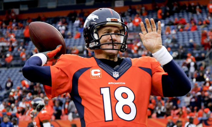 Denver Broncos quarterback Peyton Manning warms up prior to an NFL divisional playoff football game against the Indianapolis Colts, Sunday, Jan. 11, 2015, in Denver. (AP Photo/Jack Dempsey)