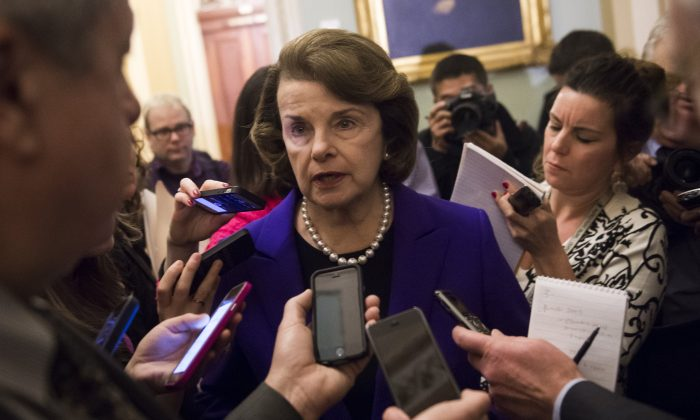 Senate Intelligence Chairwoman Dianne Feinstein (D-Calif.) (C) speaks to reporters about the committee's report on CIA interrogations at the U.S. Capitol on Dec. 9, 2014. (Saul Loeb/AFP/Getty Images)