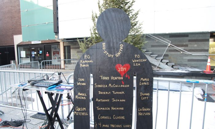 A decorated sign with the names of people who died of gun violence in the Bedford-Stuyvesant neighborhood of Brooklyn in 2014, shown at an anti-gun-violence rally at the Restoration Plaza in Brooklyn, on Sunday, Jan. 11, 2015. (Annie Wu/Epoch Times)
