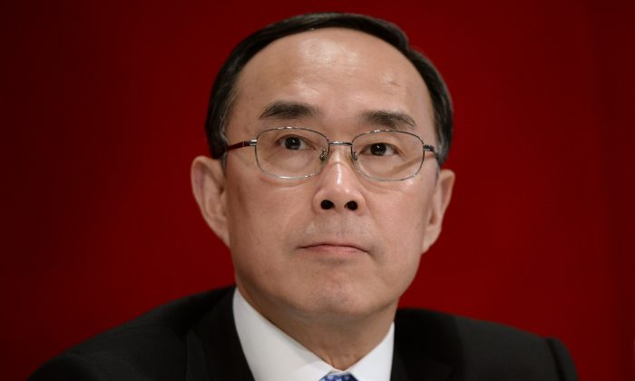 Chairman and CEO of China Unicom Chang Xiaobing speaks during a press conference in Hong Kong on Aug. 8, 2013. The company is alleged to be able to spy on its users, according to a Chinese security website. (Dale de la Rey/AFP/Getty Images)