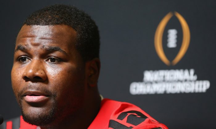 Cardale Jones #12 of the Ohio State Buckeyes talks with the media during Media Day for the College Football Playoff National Championship at Dallas Convention Center on January 10, 2015 in Dallas, Texas. (Photo by Ronald Martinez/Getty Images)