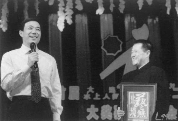 The disgraced former Politburo member Bo Xilai (L) is seen in this photo with Chinese actor Zhao Benshan (R). Chinese media have speculated that Zhao's dealings with Bo have resulted in Zhao being targeted for investigation. (Weibo.com)