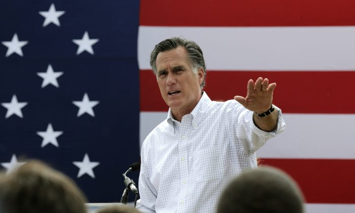 Mitt Romney, the former Republican presidential nominee, addresses a crowd of supporters while introducing New Hampshire Senate candidate Scott Brown at a farm in Stratham, N.H., on July 2, 2014.  (AP Photo/Charles Krupa)