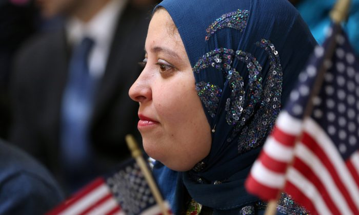 Puja Nanda from India takes part in a naturalization ceremony to become an American citizen at Federal Hall in New York on March 22, 2013. (John Moore/Getty Images)