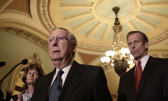 Senate Majority Leader Mitch McConnell (R-Ky.) (L) with Senate Republicans at the Capitol in Washington, D.C. on Jan. 13. McConnell wants to adjust the definition of a workweek under the ACA from 30 to 40 hours. (Win McNamee/Getty Images)