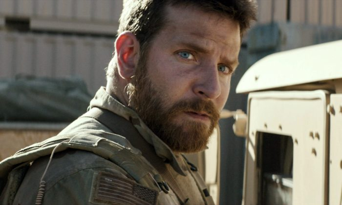 """Bradley Cooper playing the role of Chis Kyle in  """"American Sniper."""" The film grabbed $64 million at the box office this weekend for a total of $200 million domestic at the box office. (AP Photo/Warner Bros. Pictures)"""