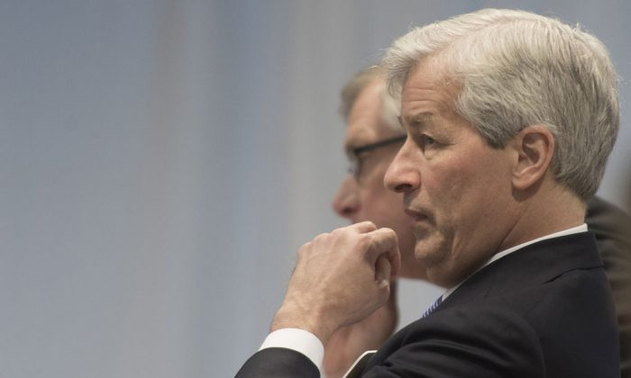 Jamie Dimon, chairman, president and CEO JPMorgan Chase, listens to US President Barack Obama address a group of business leaders at the quarterly meeting of the Business Roundtable in Washington on Dec. 3, 2014. (Nicholas Kamm/AFP/Getty Images)