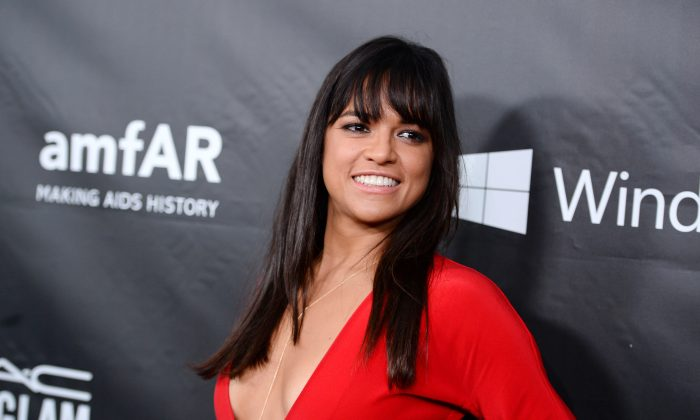 Michelle Rodriguez arrives at the 2014 amfAR Inspiration Gala at Milk Studios on Wednesday, Oct. 29, in Los Angeles. (Photo by Jordan Strauss/Invision/AP)