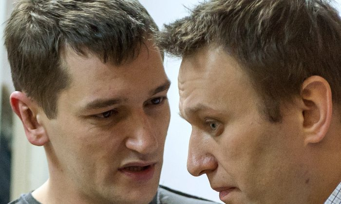 Russian anti-Kremlin opposition leader Alexei Navalny (R) and his brother and co-defendant Oleg Navalny as they attend the verdict announcement of their fraud trial at a court in Moscow on Dec. 30, 2014. (Dmitry Serebryakov/AFP/Getty Images)