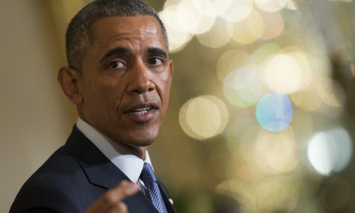 President Barack Obama speaks during a joint news conference with British Prime Minister David Cameron in the East Room of the White House in Washington, Friday, Jan. 16, 2015. (AP Photo/Evan Vucci)