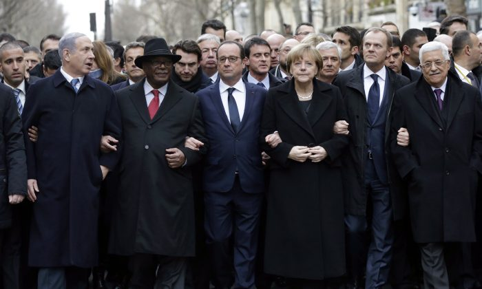 French President François Hollande (3rd L) is surrounded by head of states—(L–R) Benyamin Netanyahu of Israel, Ibrahim Boubacar Keita of Mali, Angela Merkel of Germany, EU Coucil President Donald Tusk, and Palestinian Mahmud Abbas—as they attend the solidarity march in the streets of Paris on Jan. 11, 2015. (Philippe Wojazer/AFP/Getty Images)