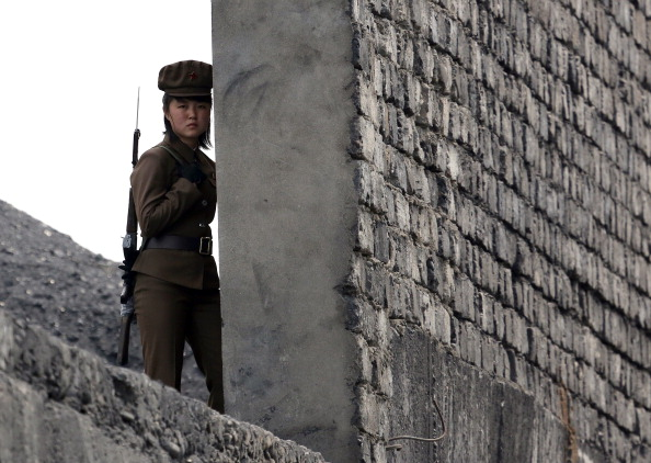 A North Korea woman soldier patrols the bank of the Yalu River in North Korea. (STR/AFP/Getty Images)