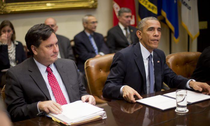 President Barack Obama receives an update on the Ebola response in the White House in Washington on Nov. 18, 2014. At left is Ebola Response Coordinator Ron Klain. (AP Photo/Pablo Martinez Monsivais)