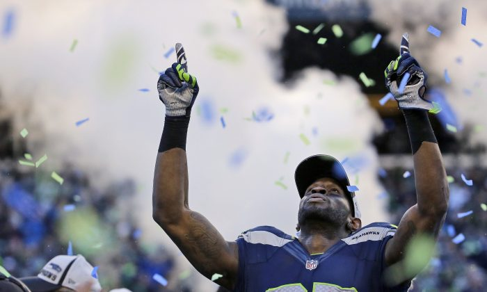 Seattle Seahawks' Ricardo Lockette celebrates after during overtime of the NFL football NFC Championship game against the Green Bay Packers Sunday, Jan. 18, 2015, in Seattle. The Seahawks won 28-22 to advance to Super Bowl XLIX. (AP Photo/Ted S. Warren)