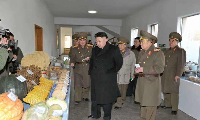 North Korean dictator Kim Jung Un is shown inspecting the North Korean army's command, in an undated photo released from the state-run Korean Central News Agency on Jan. 12, 2014. The Chinese regime is propping up North Korea, states a recent report. (AFP/KCNA VIA KNS)