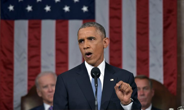 President Barack Obama delivers his State of the Union address to a joint session of Congress on Capitol Hill on Tuesday, Jan. 20, 2015, in Washington. Vice President Joe Biden and House Speaker John Boehner of Ohio, listen in the background. (Mandel Ngan, Pool/AP)