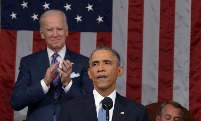 President Barack Obama delivers his State of the Union address to a joint session of Congress on Capitol Hill on Jan. 20, 2015, in Washington, as Vice President Joe Biden applauds and House Speaker John Boehner of Ohio, listens. (AP Photo/Mandel Ngan)