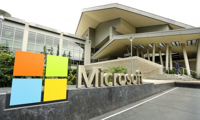 Microsoft Corp. signage outside the Microsoft Visitor Center on July 3, 2014. Microsoft is exiting the online ad business and offloading its work to AOL and AppNexus. (Ted S. Warren/AP Photo)