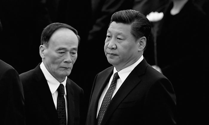 In this file photo, Chinese Communist Party head Xi Jinping (R) stands with Secretary of the Central Commission for Discipline Inspection Wang Qishan (L), on Sept. 30, 2014 in Beijing, China. Over the past two years Wang has carried out an unprecedented anti-corruption campaign on behalf of Xi. (Feng Li/Getty Images)