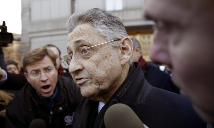 New York State Assembly Speaker Sheldon Silver is surrounded by media as he leaves a federal courthouse in New York, Thursday, Jan. 22, 2015. Silver, 70, was arrested Thursday on public corruption charges and accused of using his position to obtain millions of dollars in bribes and kickbacks, masked as legitimate income. (AP Photo/Seth Wenig)
