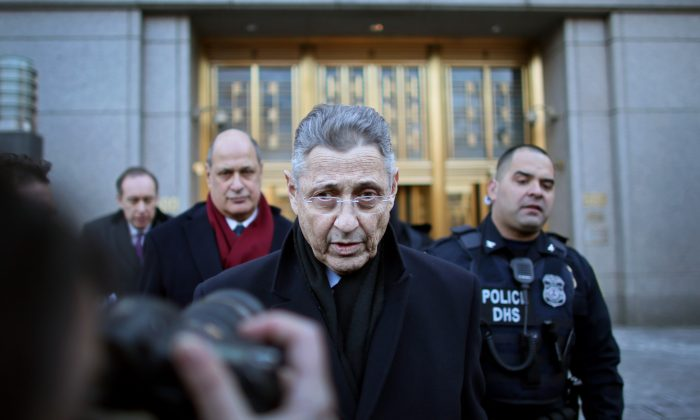 New York State Assembly Speaker Sheldon Silver walks out of the Federal Courthouse after his arraignment in New York City on Thursday. (Yana Paskova/Getty Images)