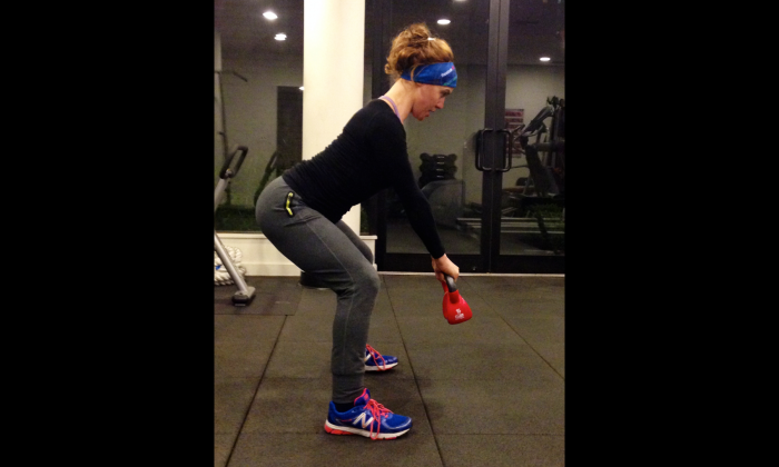 In addition to its fat-burning benefits, the kettlebell swing can help extend your posture and even reduce back pain by increasing stability in your lower back. (Courtesy of Ashely Whitson)