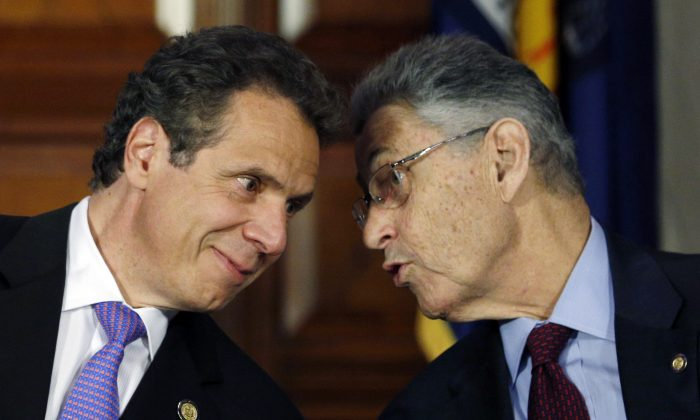 In this June 19, 2014 file photo, New York Gov. Andrew Cuomo, left, and Assembly Speaker Sheldon Silver, D-Manhattan, talk during a news conference announcing an agreement on legislation legalizing medical marijuana in Albany, N.Y.  Silver was charged by federal prosecutors on Thursday on corruption and bribery charges. (AP Photo/Mike Groll, File)