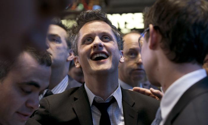 Box, Inc. Chairman, CEO & co-founder Aaron Levie waits for his company's IPO on the floor of the New York Stock Exchange, Friday, Jan. 23, 2015.  (AP Photo/Richard Drew)