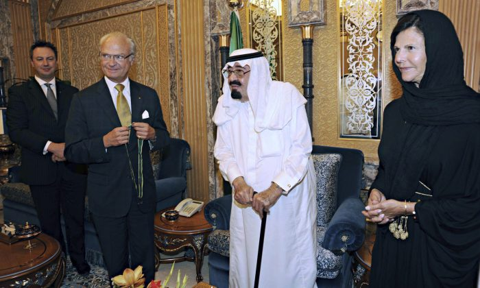 In this Friday, Sept. 30, 2011, file photo released by Saudi Press Agency, King Abdullah of Saudi Arabia, center, poses for a picture with King Carl Gustaf XVI of Sweden, center left, and Queen Silvia, right, before King Abdullah received the Wolf Bronze medal from the Swedish King in Riyadh, Saudi Arabia. On early Friday, Jan. 23, 2015, Saudi state TV reported King Abdullah died at the age of 90. (AP Photo/SPA, File) EDITORIAL USE ONLY, NO SALES