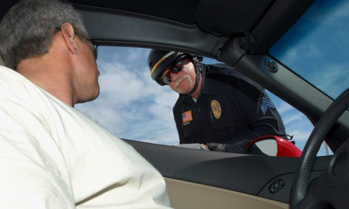 A file photo of a police officer speaking with a driver. (Moodboard/Moodboard/Thinkstock)