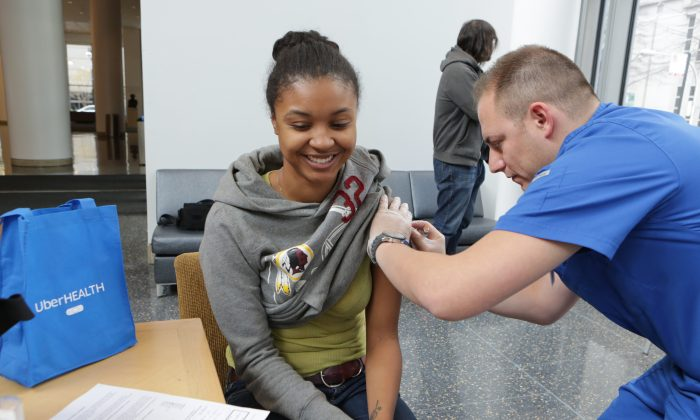 Medical student Chelsea Spriggs gets a flu vaccination from Nurse Jerry Palacios at UberHealth day in Chicago on Nov. 18, 2014. Dr. Michael Bell thinks a flu pandemic could overwhelm hospitals. (Jean-Marc Giboux/AP Images for Uber)