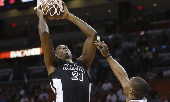 Oklahoma City Thunder's Russell Westbrook (0) defends Miami Heat's Hassan Whiteside (21) during the first half of an NBA basketball game in Miami, Tuesday, Jan. 20, 2015. (AP Photo/J Pat Carter)