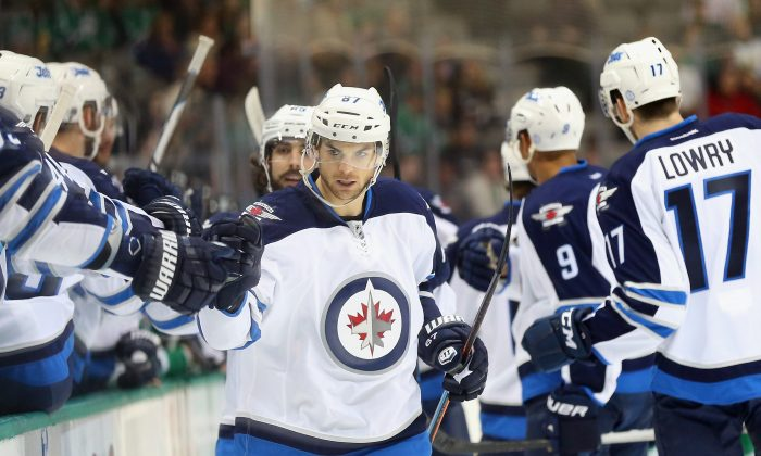 Michael Frolik celebrates his goal against the Dallas Stars at American Airlines Center on Jan. 15, 2015 in Dallas, Texas. The Winnipeg Jets play in the toughest division in the NHL and are on pace to make the playoffs. (Ronald Martinez/Getty)