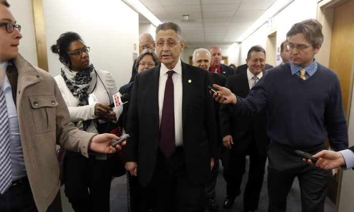 New York State Assembly Speaker Sheldon Silver, D-Manhattan, talks to the media after leaving his legislative office on Monday, Jan. 26, 2015, in Albany, N.Y. (AP Photo/Mike Groll)