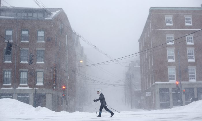 "Lisetta Shah cross-country skis on Commercial Street in Portland, Maine, Tuesday, Jan 27, 2015, during a winter storm in downtown Portland, Maine. ""I'll probably never get another chance to ski in the city,"" she said, explaining why she was outing the blizzard. Forecasters with the National Weather Service in Gray have said that much of southern Maine will see 12 to 18 inches of snow, while small bands of intense snowfall will increase those totals in localized areas. (AP Photo/Robert F. Bukaty)"
