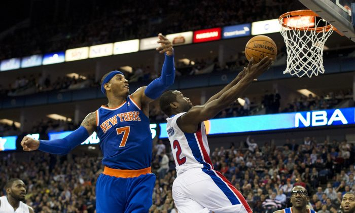New York Knicks' forward Carmelo Anthony (2nd L) tries to block the ball as Detroit Pistons' guard Will Bynum (C) goes to the hoop during their NBA basketball game at the O2 Arena in London on January 17, 2013. (AFP/Getty Images)